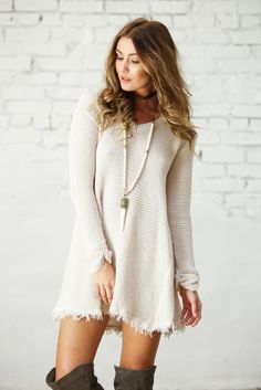 Who doesn't love a sweater dress? The Renee Dress is the perfect closet staple, featuring a raw hem and earthy tones. Pair with over the knee boots and layered necklaces and you'll reach boho chic per