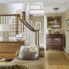 features oak-stained handrails over painted spindles. The homeowner designed the new stairwell with a cathedral ceiling and a skylight, saying it adds a sculptural elem. Second Floor Addition, Home, Home Remodeling, Second Floor, New Staircase, Finishing Basement, Home Additions, Ranch House, Room