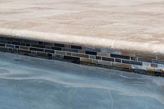 Interlocking OceanScapes Blackies tile gives this pool's waterline a distinct appearance. Arizona Pools, Pond Bridge, Low Water Landscaping, Florida Pool, Pool Finishes, Pool Remodel, Pool Coping, Beautiful Pools, Swimming Pools Backyard