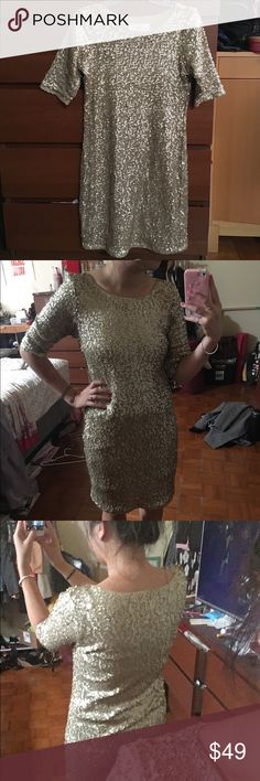 Sequin Gold Dress 3/4 sleeve, high back. Cotton lining so you don't feel the sequins from the inside. I'm a size S, so this fits pretty comfortably. A&F runs semi small anyways. Dress is labeled Large but I wear a small and its fits great. Abercrombie & Fitch Dresses Mini
