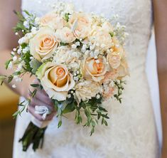 Lovely Wedding Bouquet: Peach Roses, Peach Spray Roses, Peach Carnations, White Baby's Breath (Gypsophila) + Greenery