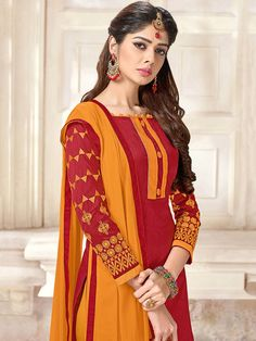 20231f5fa1 Sultry Maroon chanderi cotton casual wear straight cut suit. Having fabric  chanderi cotton. The embroidery work seems chic and great for any party.