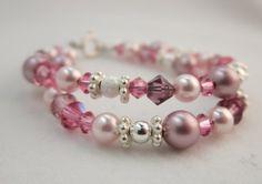 Baby Bracelet Double Layered Pearl and Swarovski Crystal, http://www.amazon.com/dp/B008FEROFM/ref=cm_sw_r_pi_awd_3tmrsb11CSFRC