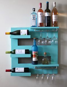 Gorgeous Nautical Blue wall hanging wine rack by Argyle Pines. Wall mounted wine rack that is sure to bring inspiration to your home decor. Repin to your inspiration board!