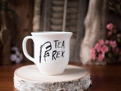 Tea-Rex >> Ceramic Coffee Mug >> Coffee Cup >> Hand Painted >> Unique T-Rex Design >> Customizable by HappyAbout on Etsy https://www.etsy.com/listing/203535186/tea-rex-ceramic-coffee-mug-coffee-cup