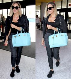 Khloe Kardashian chose to wear comfortable casual garb for her flight, she made sure her accessories were paparazzi-worthy