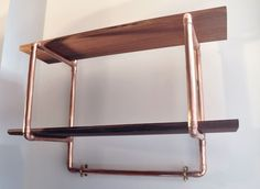 Copper pipe reclaimed wood shelving with coat hooks