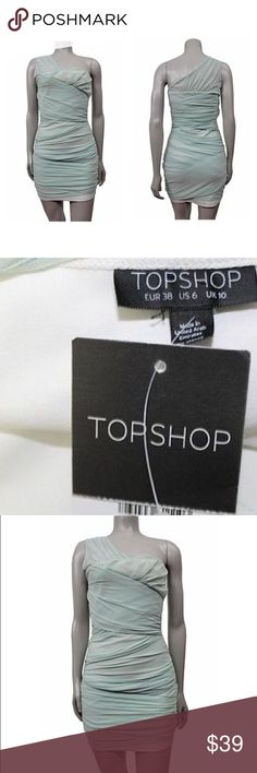NWT TopShop one shoulder mint mini dress New with tags size 6. There is a tiny stain shown in 3rd pic, not noticeable when worn. Stretchy and comfy material. Topshop Dresses One Shoulder