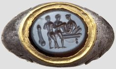 A Roman silver ring with erotic intaglio, 3rd century