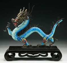 """A Chinese Antique Jeweled Filigree Cloisonne Silver Dragon: inlaid with red coral beads, presented on a wood stand, of Qing Dynasty  Dimensions: L: 9-1/2"""""""