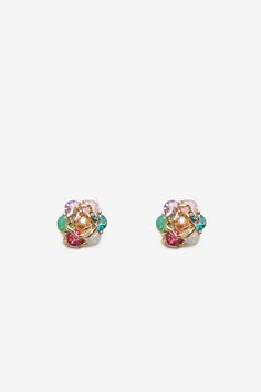 Como la flor! A pair of glitzy and glam stud earring, featuring a multi-colored rhinestone rose body and gold-polished metal body. Optional post backs or clip backs. $5.50