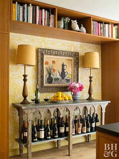 Try using up otherwise wasted space with a bookshelf. Chances are good you rarely need more than one book at a time, so keeping books in sight but out-of-reach is actually a more storage-friendly solution than keeping items used more frequently, such as wine bottles, up high.