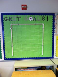 Our theme is showing your true grit, or determination.  Plus we added FIFA so I made Grit Goals.  The students set one goal for themselves, wrote it on a die cut soccer ball, and if they achieve it they put it in the goal!  SCORE!