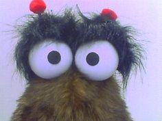 Puppet blinking eye mechanism