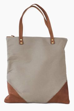 We can't get enough of this perfect everyday tote! Marketa made this beautiful khaki canvas and camel leather combo just for www.mooreaseal.com. We love the way these warm tones can be styled year rou