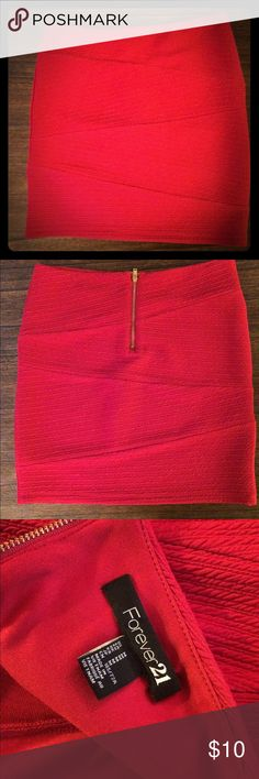 "Red skirt Fitted, stretchy material. Very lightly worn. Can be worn high waist, or pulled down a little lower. Hits mid thigh on me when worn a little higher (5'5"") Forever 21 Skirts"