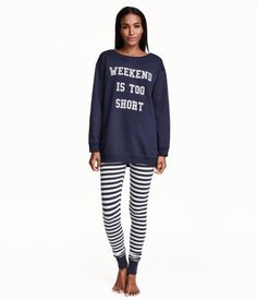 Pyjama set in a soft cotton blend. Long-sleeved top in sweatshirt fabric in a longer style with a print motif on the front and ribbing at the cuffs and hem. Soft brushed inside. Leggings in soft striped jersey with an elasticated waist and ribbed hems.