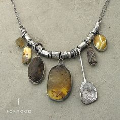Amber brown ancient glass  tourmaline  and raw sterling