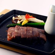 Sizzling Beef - Sizzling Fillet of Beef with Ginger & Garlic sauce.