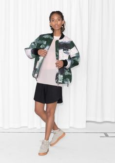 CAPSULE COLLECTION Featuring a signature woodland print, this quilted, lightly padded bomber jacket has a wide fit and ribbed neck and cuffs. Carefully detailed, it has large box pleat pockets, drawstrings at the hemline and a chunky two-way zip at front.