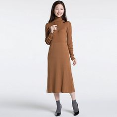 A long dress that's flattering and feminine <br>・The rib knit provides a great fit that flatters the figure. <br>・Made with a soft, thick Merino wool blend. <br>・Features an A-line silhouette with design detail at the waist. <br>・The long design makes this dress stylish and elegant. <br>・The turtleneck provides the extra warmth you need in the winter.