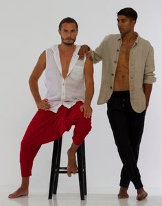 Nico Perez  - Juanito red hareem style pants shown here with white linen Leah hooded top. Louisa linen jacket worn casually here with black Galo trousers. Super elegant and cool looks for a summer sojourn!