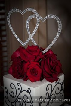 Love the two hearts on top of this simple elegant cake at the Columbia Winery
