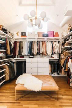 """""""We opted out of an island in the middle of the master closet for this beauty."""" Photo by New Darlings."""