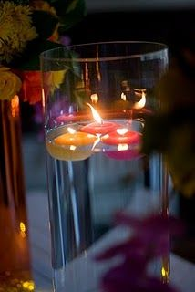 There are so many center pieces with candles!  They are my fav.  You can color the water add petals whateva!