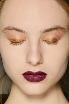 Sweep a metallic gold on the eyes and go with a deep raspberry on the lips. Keep the rest of your look neutral and matte.
