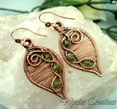 Small peridot chips contrast beautifully with woven copper in the Rustic Woven Leaf copper wire wrapped earrings. I hand-formed the frames for these earrings from pure copper and hammered them for st