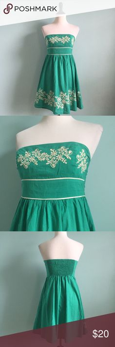Turquoise Strapless Dress Turquoise dress with cream embroidering detailing. Size small by Eunishop. Stretchy back and flattering shape. Great for summer! Comfortable and light. Eunishop Dresses Strapless