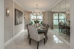 #glhomes - Riverstone New Homes in Naples, FL - The Conrad Model Home Formal Dining Room