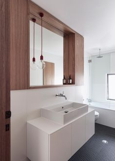 A modern bathroom with custom wood cabinetry.