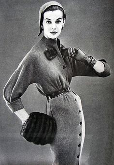 Vogue Pattern Book November 1954 Leonie Vernet/ Love the button detail on the skirt. Look how skinny this model is....back in 1954.