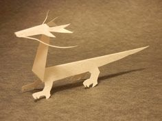 Lets make a dragon of KiriOrigami paper craft. I designed a simple dragon of Kiri-Origami paper craft for beginners. KiriOrigami is a new movement of Japanese paper craft. Kiri means cutting and Origami means foldinf paper. Basic rule of KiriOrigami is Origami And Kirigami, Origami Ball, Paper Crafts Origami, Diy Paper, Paper Art, Paper Crafting, Oragami, Craft Projects For Adults, Diy Crafts For Kids