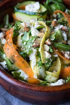 Ten MInute VEggie Ribbon Salad by thewanderlustkitchen: Ten minutes and a trusty vegetable peeler are all you need to make this easy veggie ribbon salad. Tossed in a homemade dressing and studded with crunchy almonds and tangy feta cheese, this colorful salad is the perfect potluck dish. #Salad #Ribbon #Carrot #Zucchini #Yellow_Squash #FEta #Healthy