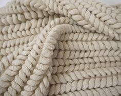 Innovative knit sample with intricate textures inspired by organic & architectural forms; textiles for fashion // Emma Brooks