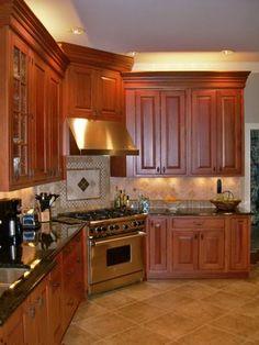 mahogany colored cabinets with backsplash design over stove idea