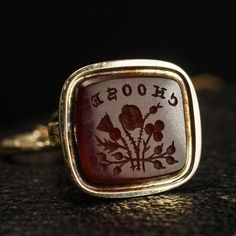 This exquisite wax seal fob dates to the mid Victorian period. The 15k gold fob is fashioned in a foliate motif, with leaf elements at the neck and an ornate, organic chasing along its rectangular head and decorative split ring. The carnelian intaglio features the word