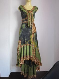 RESERVED..a gorgeous mottled forest green bohemian gypsy dress with ruffles of lace and vintage motifs.... $95.00, via Etsy.
