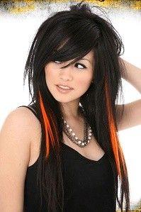 Black emo hairstyle with orange streaks.
