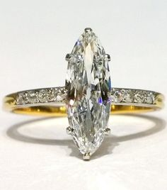 An antique gold, platinum and diamond ring, French, circa 1900. Set to the centre with a single marquise diamond weighing 1.48 carats, colour E, clarity I1, mounted in 18k gold and platinum claw setting with small old-cut diamond shoulders. With French import marks. #antique #ring