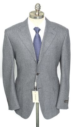 Mottled gray wool and trim cut makes this Canali suit a modern masterpiece.  |  Get in on this! http://www.frieschskys.com/suits  |  #frieschskys #mensfashion #fashion #mensstyle #style #moda #menswear #dapper #stylish #MadeInItaly #Italy #couture #highfashion #designer #shopping