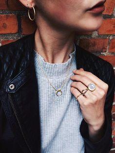 Red lips, grey knit, leather jacket, tusk necklace, hoop earrings gold jewellery