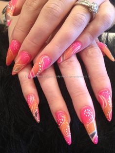 Stiletto nails with pink and orange acrylic and freehand white and Swarovski crystal nail art