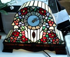 Tiffany Style Stained Glass Mantle Clock Table Lamp with Blue & Plum Flowers. $69.99, via Etsy.