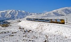 TranzAlpine Express surrounded by snowy mountains, Christchurch to Greymouth, West Coast, New Zealand. ^James Print
