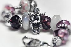White and deep plum bracelet with the Trollbeads Elf by Ginger from the Trollbeads Gallery Forum.