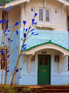 House with bottle tree in Jackson, MS And haint blue settings the doors and windows to dispel evil spirits